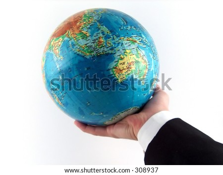 businessman hand holding the earth
