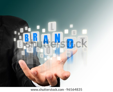 Businessman hand holding with blue brand  alphabet streaming images