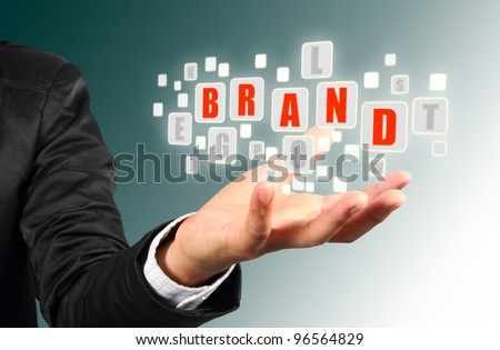 Businessman hand holding with red brand  alphabet streaming images