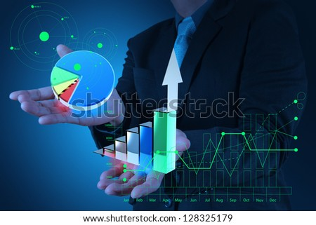 businessman hand holds graph bar and pie growth as concept