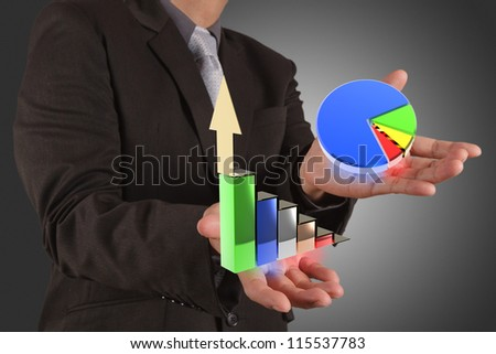 businessman hand holds graph bar growth - stock photo