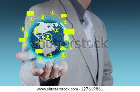 businessman hand holds social network as concept