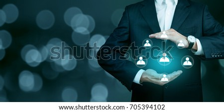 businessman hand network in screen on dark background #705394102
