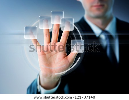 Businessman hand on a future touch screen