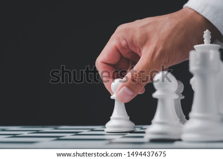 Businessman hand play with chess game. concept of business strategy and tactic.strategy, management or leadership concept #1494437675