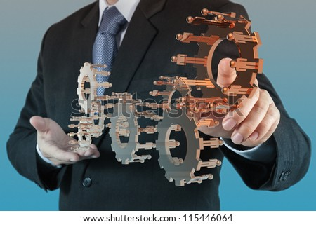 businessman hand point bronze gear to success as concept