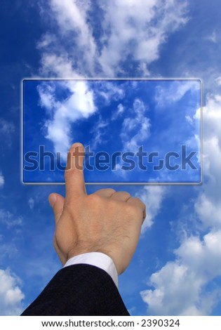 businessman hand pointing at a transparent screen over a blue cloudy sky