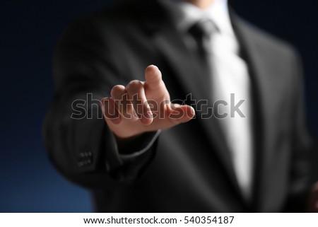 Businessman hand pointing, closeup #540354187