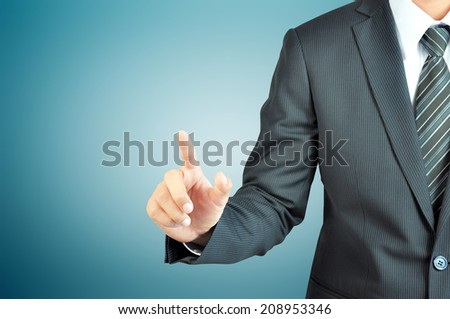 Businessman hand pointing on empty space - can be used as business template stock photo