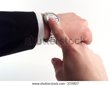 businessman hand pointing to watch - stock photo