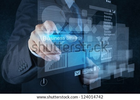 businessman hand points to business strategy as concept