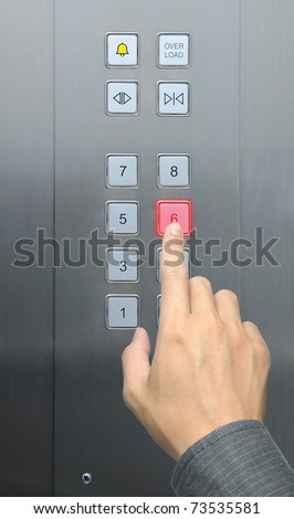businessman hand press 6 floor in elevator - stock photo
