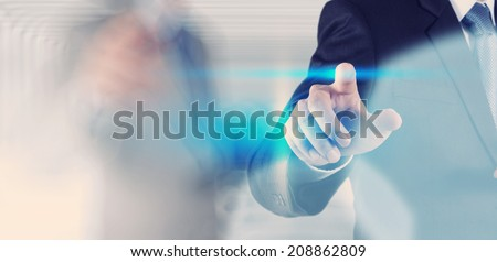businessman hand pressing button with contact on virtual screens as concept