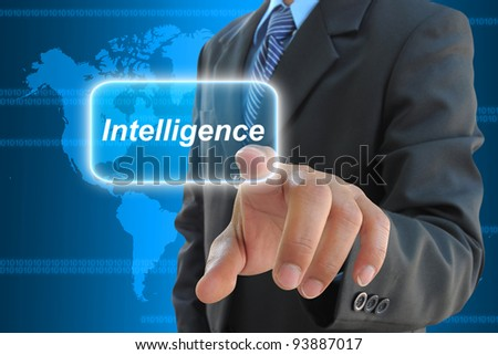 businessman hand pressing intelligence button on a touch screen interface