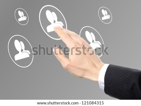 businessman hand pressing social network icon on a virtual background