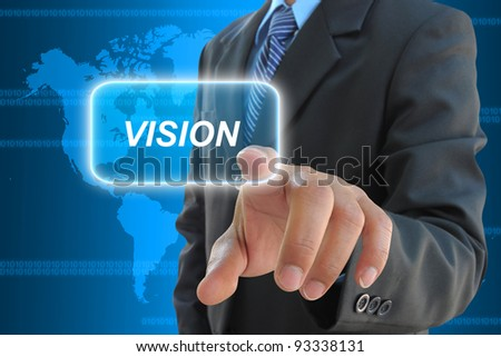 businessman hand pressing vision button on a touch screen interface