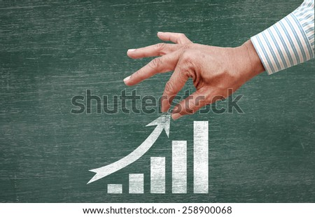 businessman hand pulling increase index arrow Stock photo ©