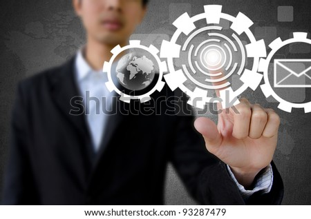 businessman hand pushing button with touch screen interface