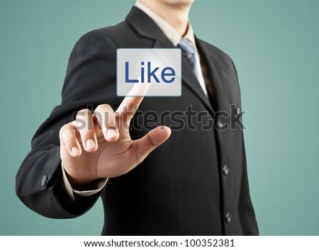 businessman hand pushing like button