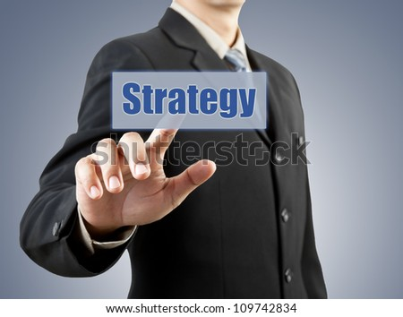 businessman hand pushing strategy button