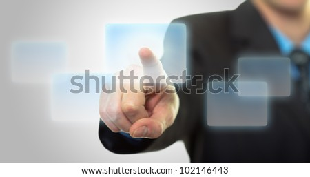 Businessman hand pushing the virtual button as concept