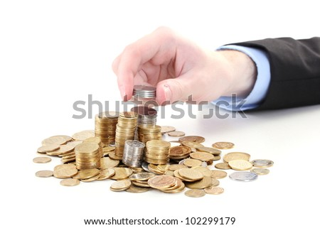 Businessman hand put coins isolated on white