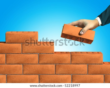 Businessman hand putting a brick on a new wall. Digital illustration