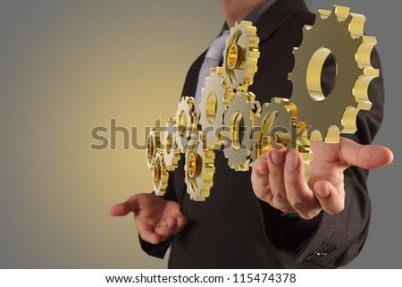 businessman hand show golden gear to success as concept