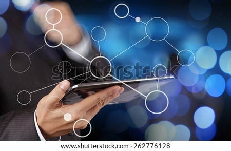 businessman hand showing  blank flow chart on new modern computer as concept with bokeh exposure