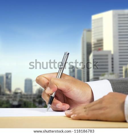 Businessman hand signing document