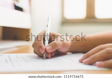 Businessman hand signing the document business contract agreement Stock fotó ©