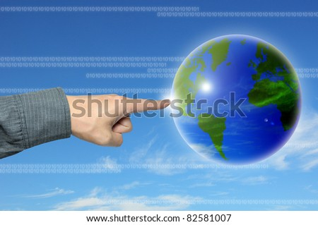 businessman hand to world - stock photo