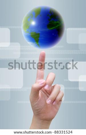 businessman hand to world - stock photo