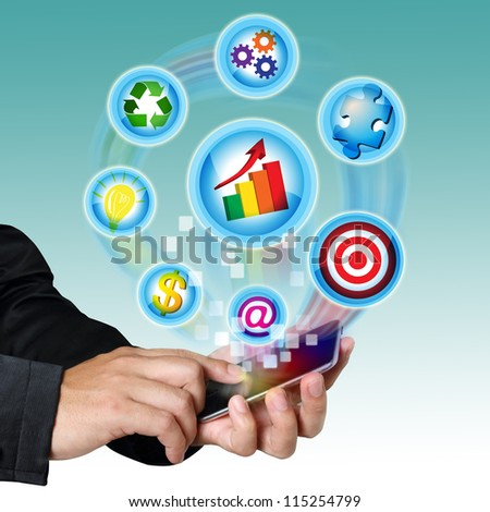 Businessman hand touch screen mobile with business symbols icons.