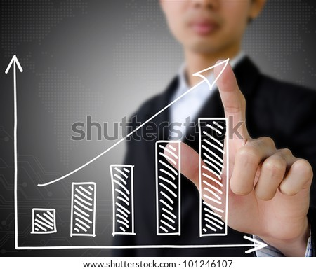 businessman hand touch virtual graph on the screen.