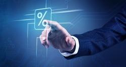 Businessman hand touches virtual percent icon.