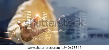Businessman hand touching and analysing banking and investment growth graph to develop smart financial decision for business plan strategy in expand business and increase sale profit. Stockfoto ©