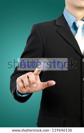 businessman hand touching authority  button