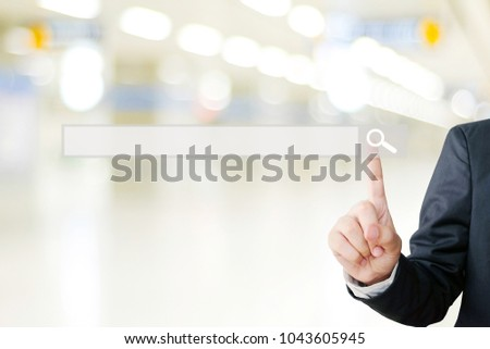 Businessman hand touching blank search bar over blur background, business and technology concept, search engine optimization, web banner #1043605945