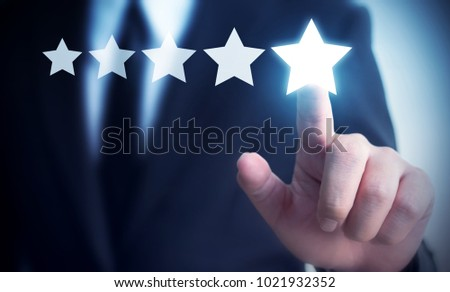 Businessman hand touching five star symbol to increase rating of company concept, Copy space background for your title #1021932352