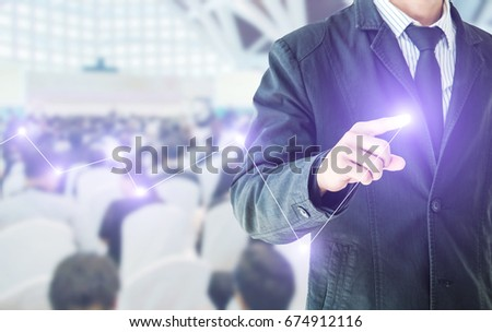 businessman hand touching flying digital data network in his hand 3D rendering, blurred background of business people in conference hall or seminar room with attendee background. #674912116