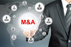 Businessman hand touching M&A (Merger and Acquisition) sign  on virtual screen