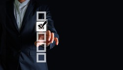 Businessman hand touching select best choice, selective concept idea.