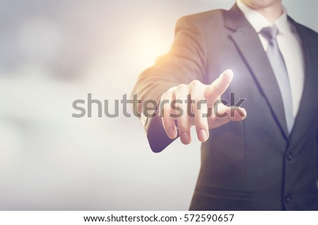 Businessman hand touching virtual screen, modern background concept , can put your text  at the finger, copy space #572590657