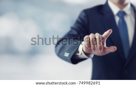 businessman hand touching...