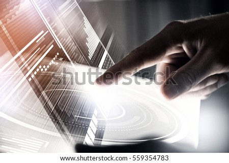 Businessman hand touching with finger virtual panel with infographs #559354783