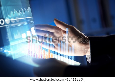 Businessman hand touching with finger virtual panel with infographs #634112234