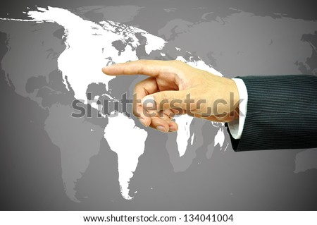 Businessman hand touching world map