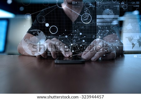 Businessman hand using mobile phone with digital layer effect as business strategy concept                  #323944457