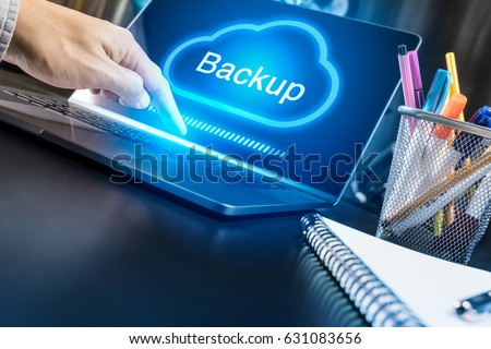 Businessman hand using modern laptop with Cloud Backup concept